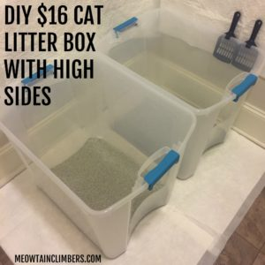 two rubbermaid containers as cat litter box in a laundry room