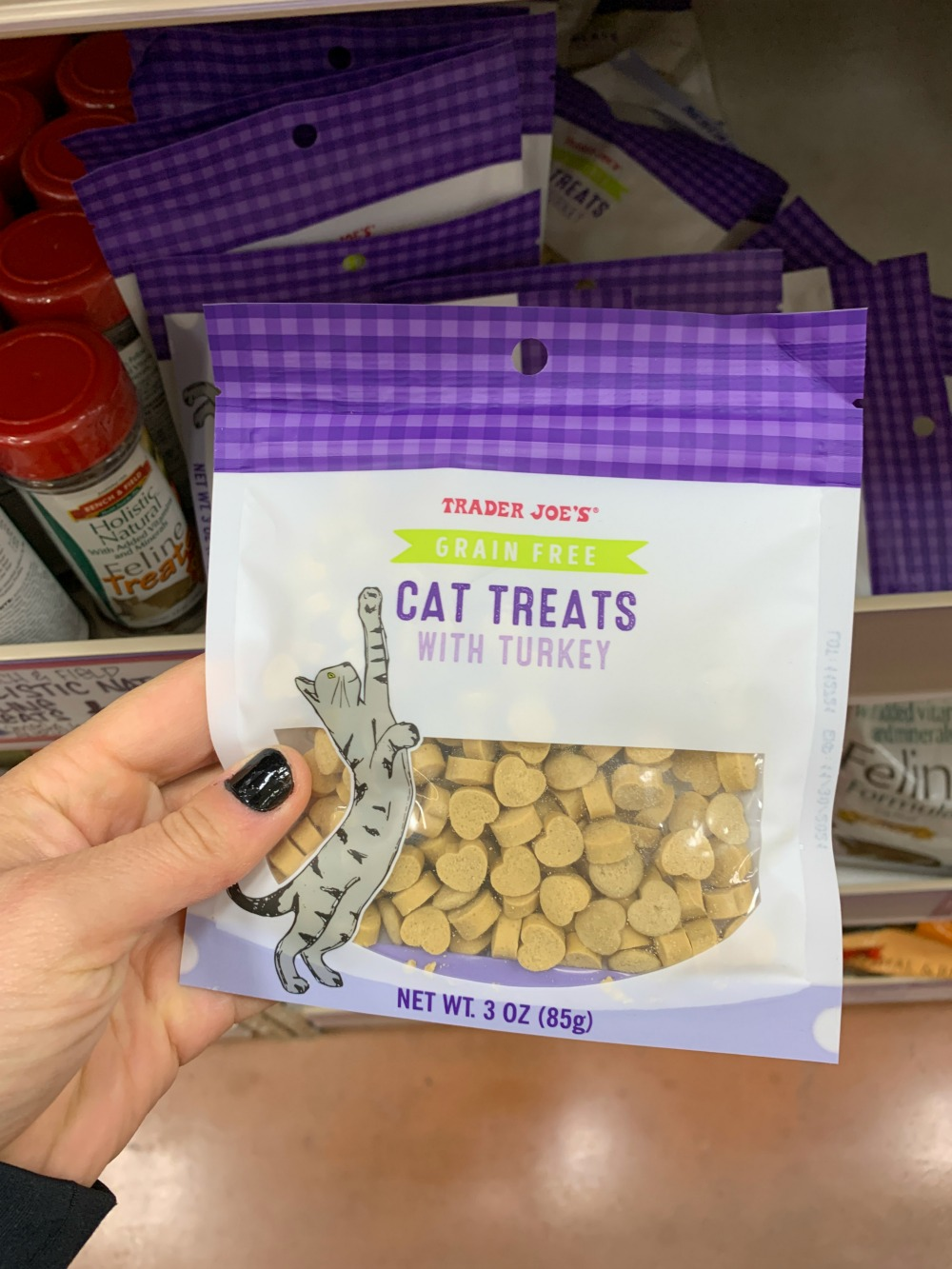 Bag of Trader Joe's grain free cat treats with turkey. Bag is white and purple.